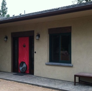 A blower door test being preformed on a straw bale home to test air tightness.