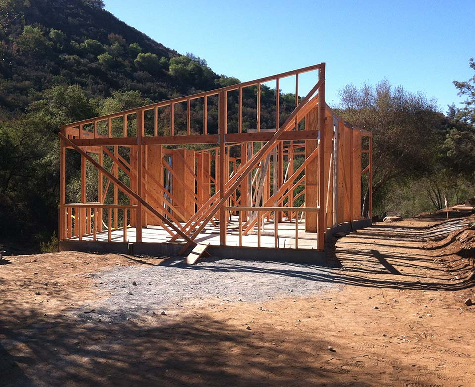 Framing in process for one of the four straw bale buildings for the Buddhist nuns' housing at Deer Park Monastery.