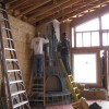 starting to plaster the kiva-style fireplace