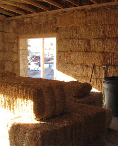 A tightly stacked straw bale wall before plaster.