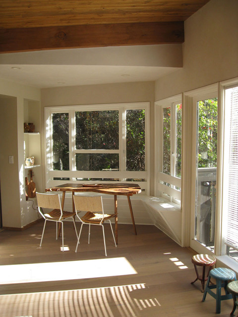 The breakfast nook with new T&G on the ceiling, new flooring, and a built-in bench.
