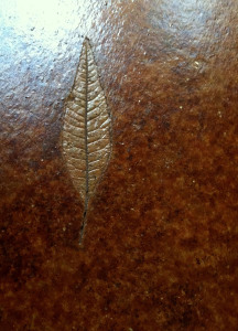 Leaf print in stained cornet floor